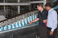 Steve Ardagh (Eagle Protect CEO) Looking At Nitrile Glove Production Line.png